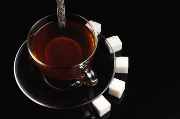 A glass cup of tea and lemon