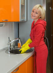 Young woman washing dishes