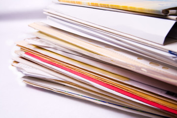 Stack of messy document folders