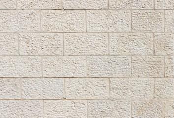 Vertical wall built of Jerusalem stone blocks