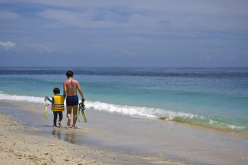 Father and Son going snorkelling