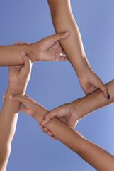 Hands forming a pentagram