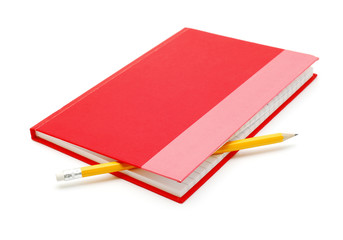 red notebook with pencil isolated