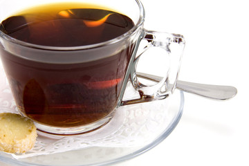 Cup of tea whith cookie on white background.