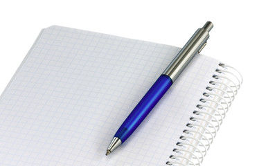 Open spiral notebook with pen