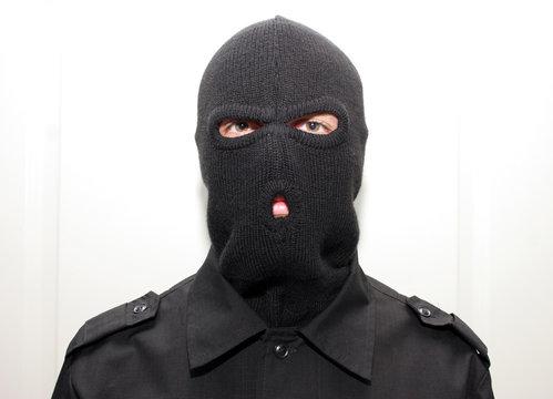 an burglar wearing a ski mask (balaclava)