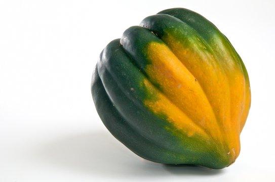 green and orange acorn squash