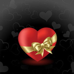Heart  on a black background with gold bow