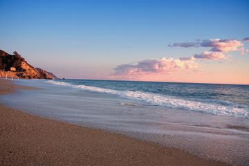 Mediterranean beach in sunset,liguria , italy