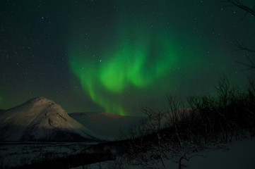 Stars, mountains and Aurora polaris