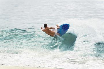 Surfer Balancing on Wave