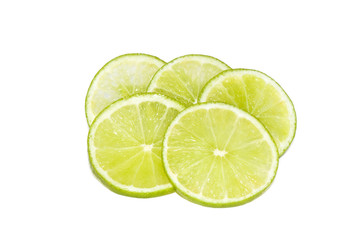 Lime slices on a bright white background