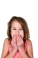 cute girl with her hands over her mouth in surprise