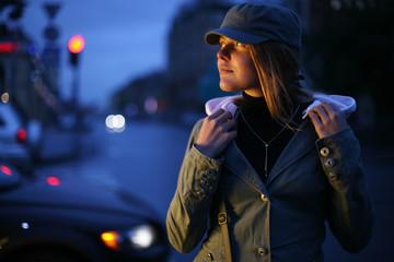 Beautiful young woman on twilight street