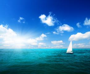 sailboat sky and ocean