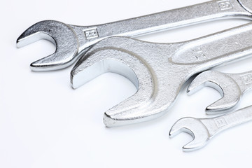 Different sizes of spanners in white background