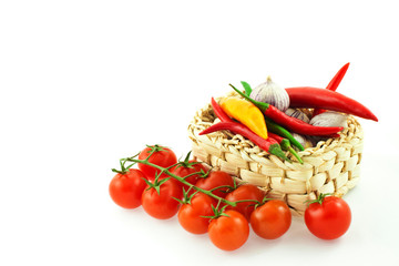 tomatoes, pepper and garlic in a basket