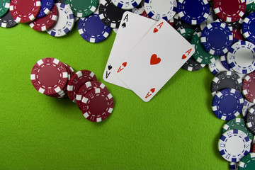 Pair of aces over poker chips