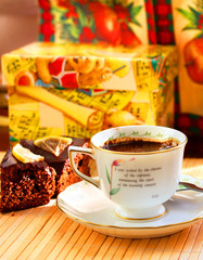 a cup of coffee and chocolate cakes