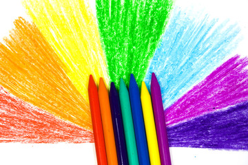 Close up children's wax pencils and semicircle