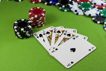 Royal flush in poker cards, chips table