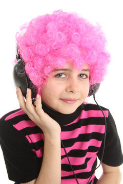 Child with pink hair and headphones