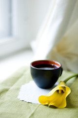 a cup of coffee and a calla