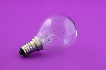 Small electrical lamp over pink background
