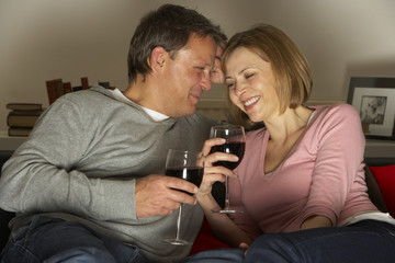 Couple Drinking Wine And Not Watching Television