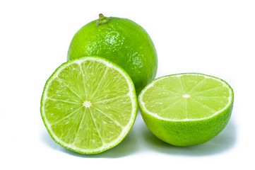 Two lime fruits, one have been slide in half