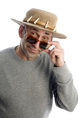 aging artist thinking  suglasses adventure hat