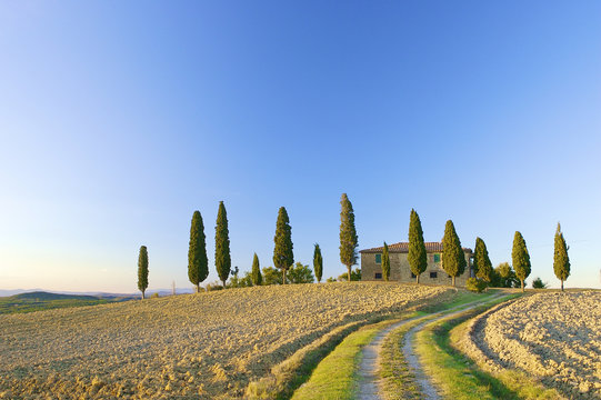 a typical Tuscan landscape in Italy with a Tuscan villa