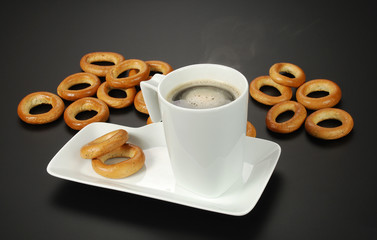 cup of black coffee and poppy bagels