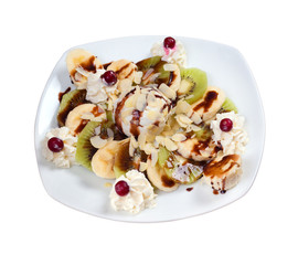 fruit salad with nut and icecream.sweet dessert
