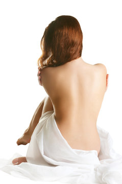 portrait of a sexy  woman, sitting with a bare back