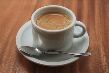 cup of espresso on wood