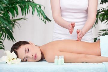 Cute girl having a back massage