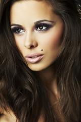 sexy brunette girl on dark background - portrait