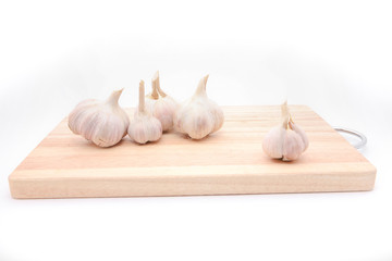 Garlics on wooden plate