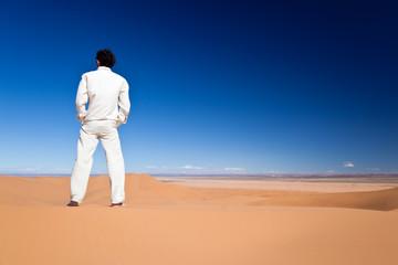 Man standing on a desert dune