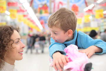 Mother and son in shop