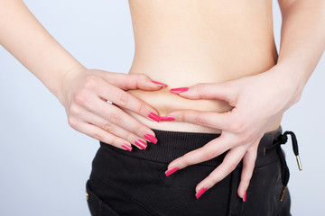 Woman pinching skin for fat test