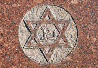 Star of David on old grunge granite tombstone
