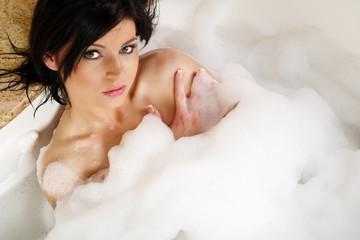 Woman in bathtub.