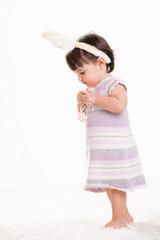 Baby girl in easter costume
