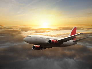 Wall Mural - Big aircraft at sunset