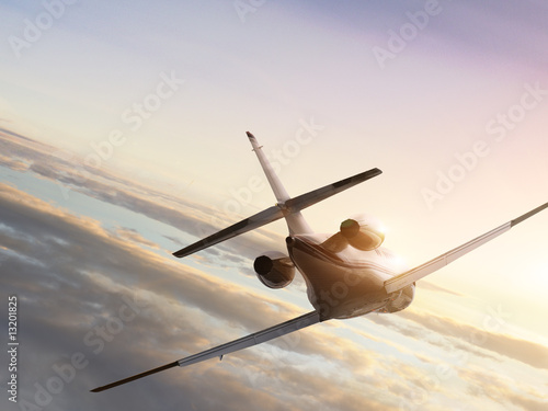 Fotobehang Jet plane at fly to the sunset