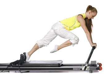 Fitness girl doing pilates on the allegro