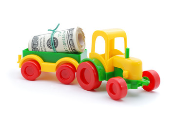 The toy tractor transortation money