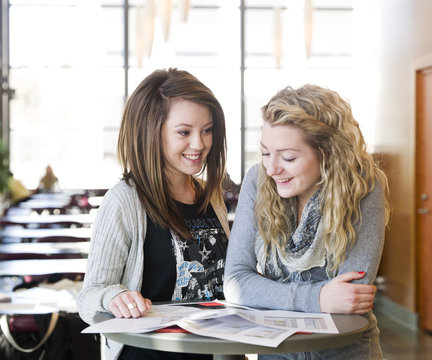 two girls studying